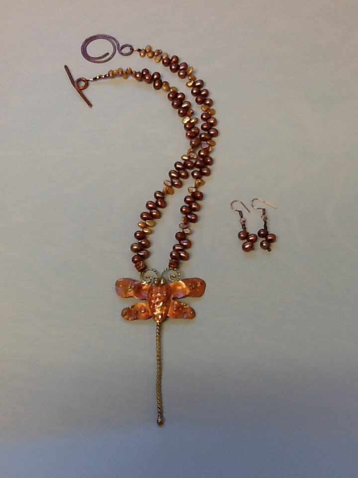 This necklace is named Anisoptera, the species name for dragonfly and which, translated from the Greek, means uneven wings.  The pendant is made in Mexico from Patty Healy (CA) designs and executed in copper and brass.