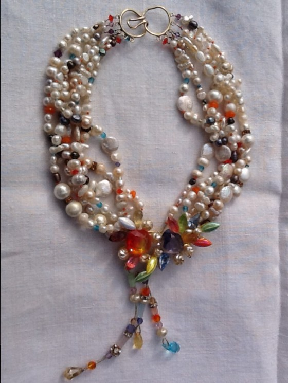 I will accept commissions combining your favorite brooch, contemporary or family antique, with my orphan pearls and appropriate other beads, probably seed beads and crystals.  The cost would be approximately $139.  We can exchange photos of your brooch and I'll give you a firm quote.