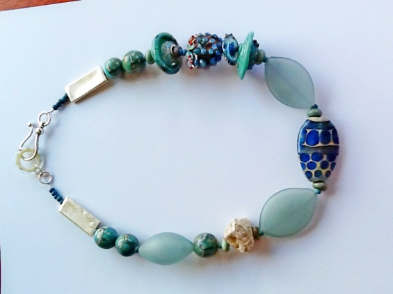 """Local women's lampwork beads feature in this necklace with silver clasp. 20"""" long, $220"""